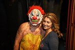 Evil clown and a beautiful supporter.